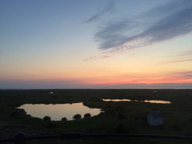 Sunset over ponds and Powder Hole, from the top of the light