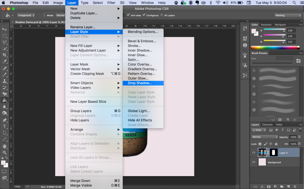 Navigating to the Drop Shadow menu item. Layer > Layer Style > Drop Shadow...